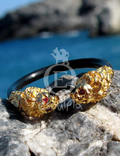 esculpta-le-cock-ring-i-in-18k-yellow-gold-and-diamonds